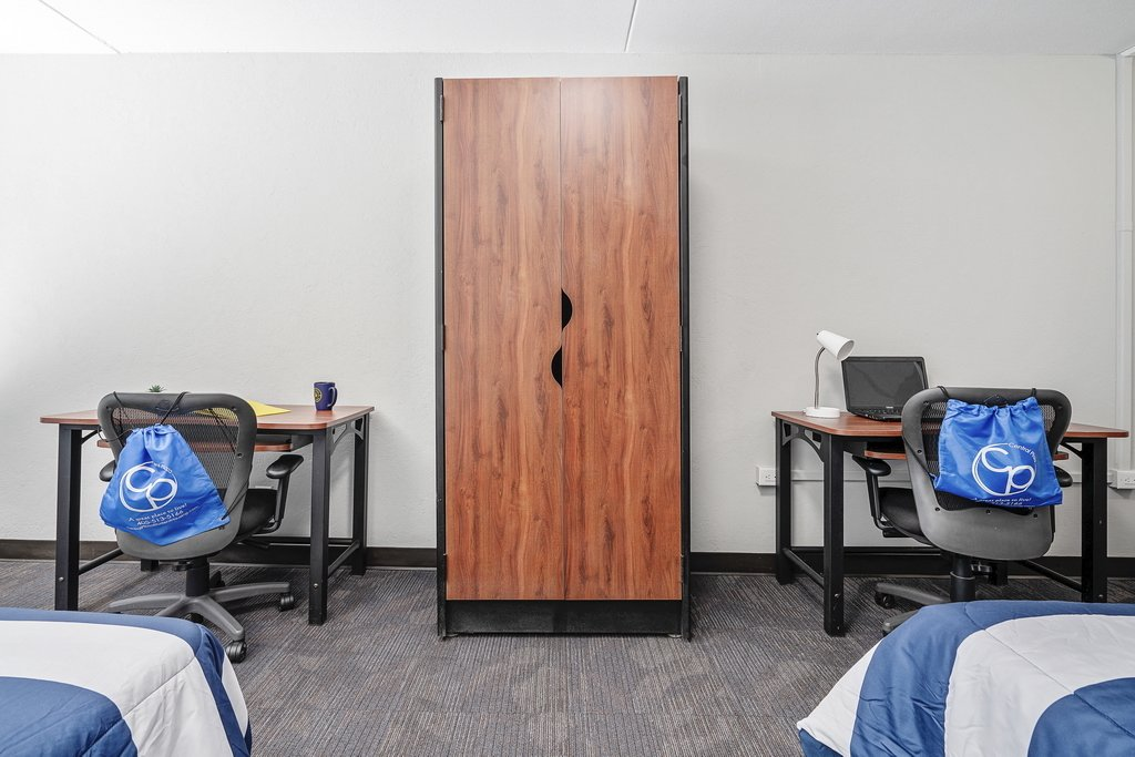 Central Plaza Student Housing Shared suite work spaces with armoire between the desks