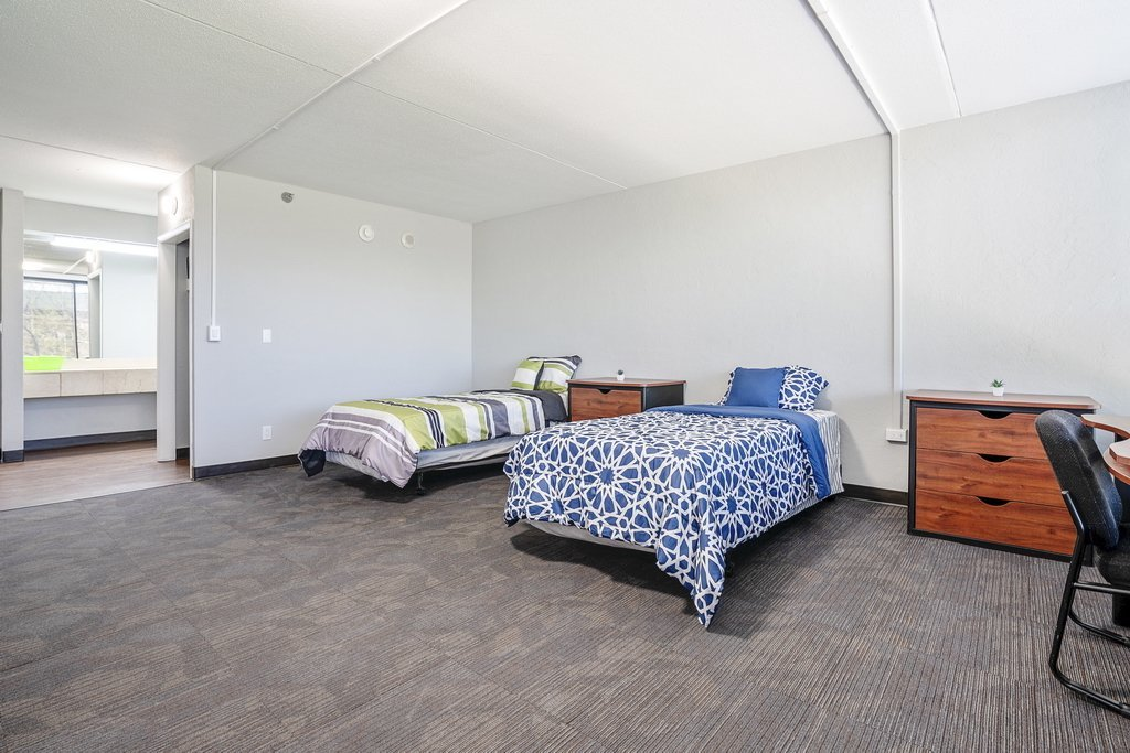 Central Plaza Student Housing shared suite with two beds and night stands